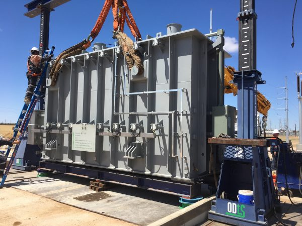 Power distribution transformers and transmission transformers concept - Unloading Distribution Tx prior to assembly and installation
